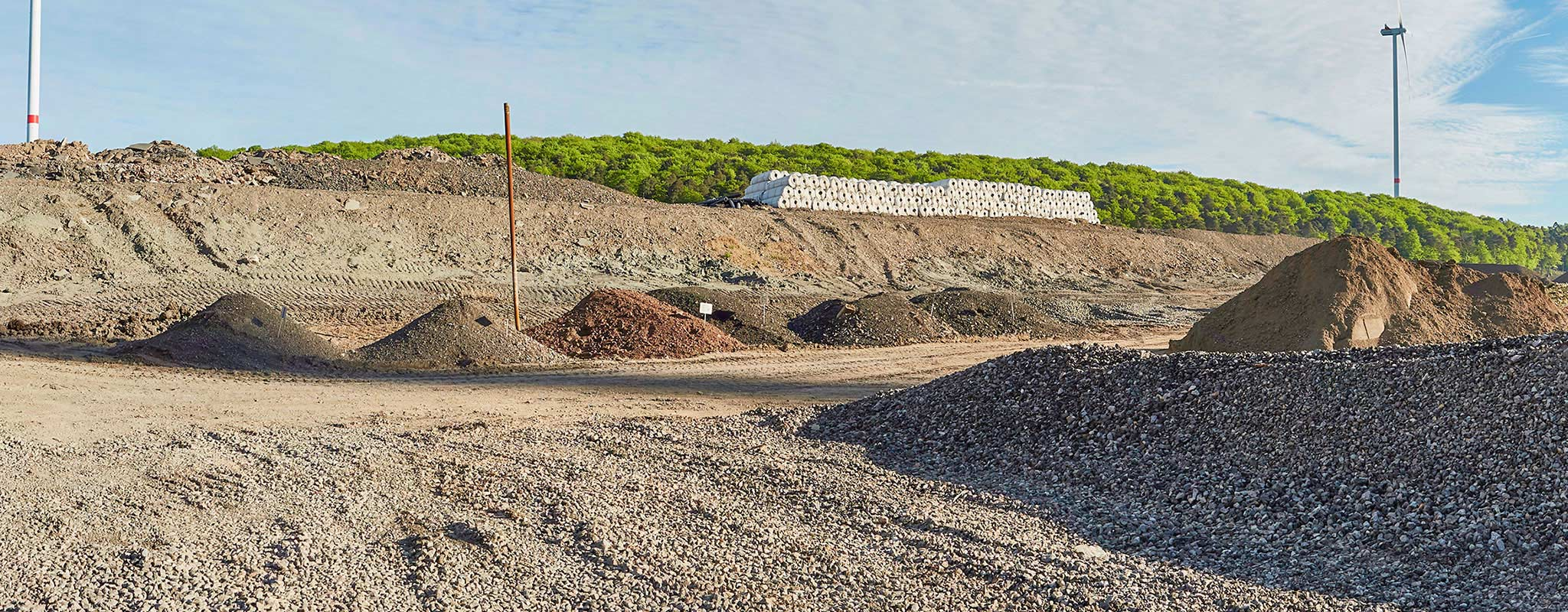 Landfill construction materials from mineral waste