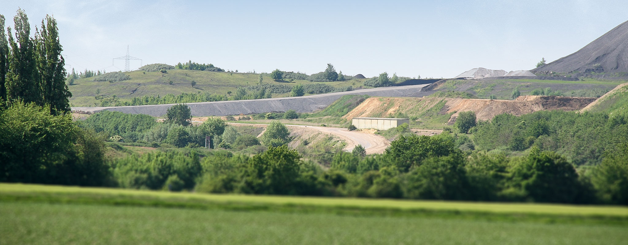Creating landfill volume by new landfill on old